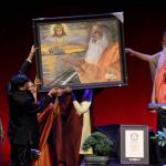 Sri.Malani offers a painting to Pujya Sri Swamiji