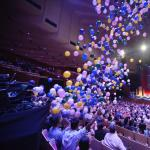 Balloons drop down as the concert concluded.